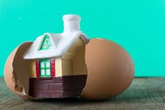 Small toy house in an egg shell stock image