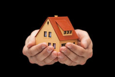 Small toy house in hands Stock Image