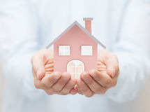 Small toy house in hands Royalty Free Stock Photography