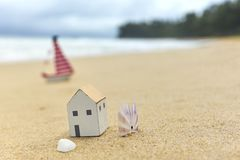 Free Small Toy House On The Beach Royalty Free Stock Photos - 94264328