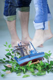 Small toy ship and boyfriend and girlfriend fee Stock Photo