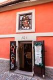Small toy shop at the Golden Lane in Prague Castle. PRAGUE, CZECH REPUBLIC - NOVEMBER 14, 2015:Souvenir toy shop at the Golden Lane (in Czech Zlatá ulička royalty free stock photos
