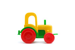 Small toy tractor isolated on white Stock Images