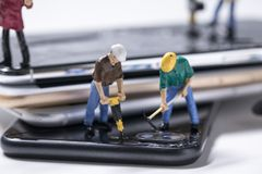 Maintenance man miniature repairing phone stock images