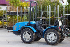 Small tractor in the backyard. Royalty Free Stock Photography