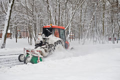 Small tractor snow removal in the park Stock Photos