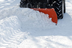 Small tractor snow removal in the park stock image