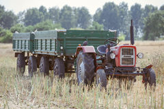 Small tractor with trailer Stock Images