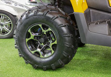 Small tractor wheel and tire Royalty Free Stock Photos