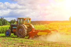 Small tractor working in the field. smallholder agriculture Stock Images