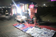SMALL TRADERS IN THE MONAS. Micro traders found in Monas, Jakarta. They peddle their wares to visitors of the region royalty free stock photo