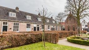 Ancient city center of Amersfoort Netherlands. Small tradiitional houses De armen de Poth in the ancient city center of Amersfoort Netherlands stock photo