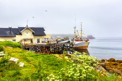 Small traditional fishing boat stands moored in Norway. Stock Image
