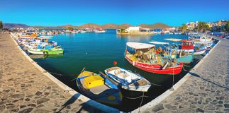 The small traditional harbor of Elounda at sunset, Crete Stock Images