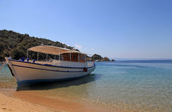 Small traditional ship on a sandy beach, Greece Royalty Free Stock Image