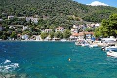 Monastiraki Fokida Harbour and Port, Greece. Small traditional wooden Greek fishing boats docked in the picturesque harbour and port, Monastiraki Fokida, or stock image