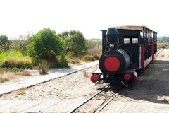 The small train connecting Santa luzia to the beach of Barril. stock photography