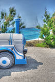 Small train parked by the sea Royalty Free Stock Photos