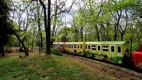 Small train and reailway in Plovdiv. PLOVDIV, BULGARIA - APRIL 15, 2017 - Children mini railway in Plovdiv, Bulgaria. Families with children riding the small stock footage