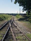 Small train station on narrow gauge. Village train station. Railroad tracks, railway traffic signs. Stock Photography