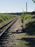 Small train station on narrow gauge. Village train station. Railroad tracks, railway traffic signs. Stock Image