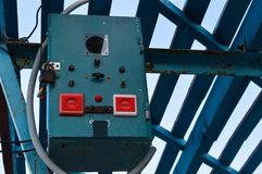 A small transformer cabinet is fixed on a high bar under a canopy. Transformer plant with switches and levers, as well as an input for electrical appliances Stock Photo