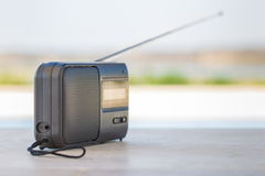 Small transistor radio with a string cord handle outside. Royalty Free Stock Image