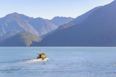 Small Ship at Fjord, Patagonia, Chile Stock Photos