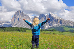 Small traveler in Alps Royalty Free Stock Images
