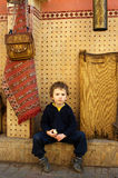 Small traveller sits on a street in Marrakesh stock images