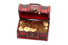 Small treasure chest of gold coins. Isolated on a white background royalty free stock photography