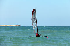 Small trimaran with sail Royalty Free Stock Photos