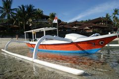 Fishing Trimaran in Bali, Indonesia. Small trimarans used as fishing boats in Indonesia. They come from the Province of Bali. The boats are all made from one royalty free stock photo
