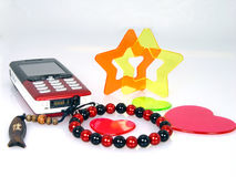 Small trinket and Mobile phone Stock Photography