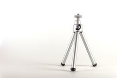 A small tripod for the camera or video camera, a handy thing Stock Photos