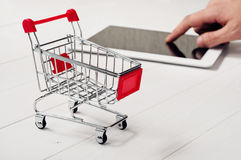 Small trolley on the wooden table Stock Photos