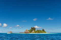 Small tropical island with Beach Villas Royalty Free Stock Photo