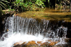A small tropical waterfall with clear water. Nature. A small tropical waterfall with clear water Stock Images