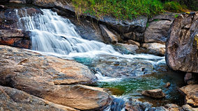 Small tropical waterfall Stock Photography