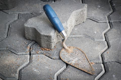 Small trowel and bricks for construction. Stock Image