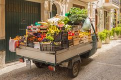 Small truck filled with vegetables and fresh fruits stock images