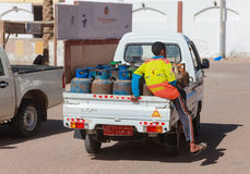 Small trucks deliver gas bottles Royalty Free Stock Photos