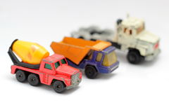 Small trucks. Small utility toy trucks worn out Royalty Free Stock Photography