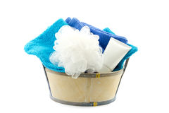 Small tub filled with bath puff, bath foam and towels Royalty Free Stock Photo