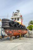 Small Tug Boat Receiving Maintenance Royalty Free Stock Photography