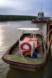 Small tug boat at ship yard Stock Photography