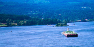 Small tug pushing huge barge Columbia River scenic Columbia Gorg Stock Photography