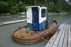 A small tugboat used for pushing rafted logs. Stock Photography