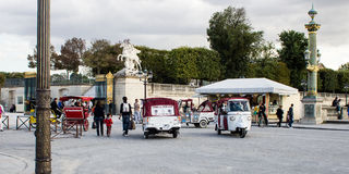 Small Tuk-Tuk taxis wait for passengers in the Place de la Concorde, Paris, France Stock Photo