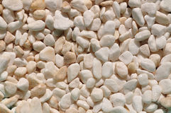 Small tumbled white quatz pebbles Royalty Free Stock Images